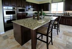Kitchen Floor Tile Ideas with dark cabinets | lovely kitchen done in greens a large kitchen with