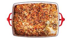 Adding Cubanelles -- a type of sweet pepper -- brings mild heat to this breakfast-perfect hash brown casserole.