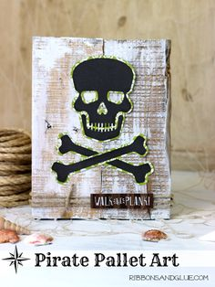 Love pirates? Check out this easy   craft made with a Silhouette cut file, pallet wood and scrapbook paper.  This quick craft project is perfect for Halloween or even a kids pirate party.