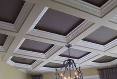 Deep coffers with offset moulding. This would do nicely in the den!