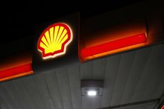 Shell oil executive boasts that his company influenced the Paris Agreement. They're also the world's ninth-largest producer of greenhouse gas emissions Shell Oil Company, Shell Gas Station, Automotive Furniture, Shells, Table Lamp, Neon Signs, California, Paris, News