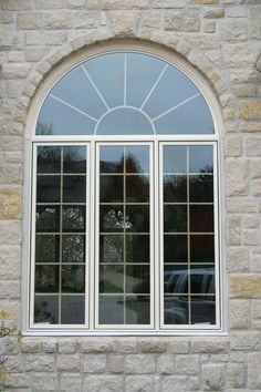 Here's a custom configuration from the Pella Architect Series - both the half moon topper window as well as the three lower casement windows have grids for that traditional divided light look.  We install #PellaWindows in Minneapolis MN.  http://www.replacementwindowsmpls.com/
