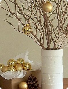 twigs and ornaments as centerpieces