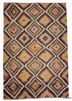 Vintage tribal kilim rug hand-woven in Antalya in 1960's and in very good condition. The white areas are cotton. Antalya is a lovely sunny city on the Mediterranean coast of southwestern Turkey.