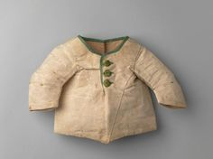 Infant's jacket for a boy, 1770-1800. Cream silk, trimmed wiht green silk ribbon, green silk covered buttons, cream linen lining.