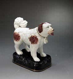 ANTIQUE STAFFORDSHIRE POTTERY FIGURE OF A ST.BERNARD DOG