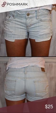 American Eagle // Distressed Denim Shorts Light wash, distressed front and back. 100% Cotton. Gently worn, but unnoticeable. Regular rise. American Eagle Outfitters Shorts Jean Shorts