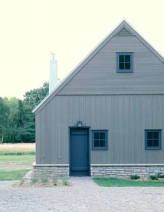 The board-and-batten wood siding was stained with a custom color. The client, who is also originally from New England, wanted to reference the coastal weathered shingles from his childhood. The minimal roof overhang and horizontal crown molding fascia boa