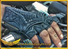 - Info - Size Chart - The Dragonscale gloves feature silky soft python leather panels in black-on-black with riveted accents extending over the knuckles. gloves (unisex) around widest part of hand cm/
