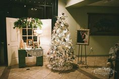 White tree with pics of the bride and groom