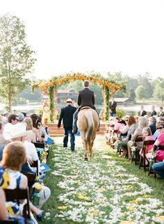 Groom rode his horse right down the aisle! Photography by Austin Gros / austingros.com