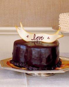 Except for the whiskey-soaked raisins studding its interior and the candied-orange base, this elegant heart-shaped cake is all chocolate: inside and out.