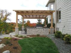 Natural stone grill area, with a pergola