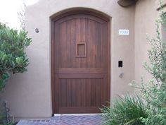 Custom wood gates and doors by Crown Garage Door & Gates. Call today for a free quote. 949-348-0458 or visit us at crownsgd.com/
