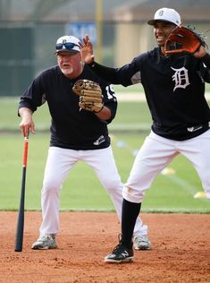 ab4365a0a782bb 2018 Detroit Tigers spring training - Tigers manager Ron Gardenhire works  with Dixon Machado during spring