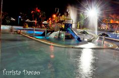 D'Leonor Inland Resort and Adventure Park's pool at night. The water changes color in seconds.