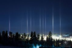 When the temperature drops below -20º Celsius, and the air has just the right amount of ice crystals, this beautiful phenomenon of light pillars happens. It's not a photographic trick, they're visible to the naked eye.