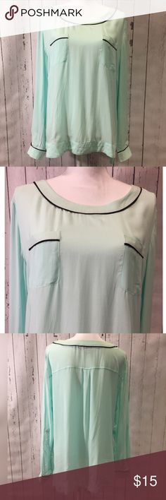 Jaclyn Smith Blouse This perfect NWOT blouse by Jaclyn Smith is casual understated elegance at its best. Soft minty / blue with black trim at cuffs, neckline and both breast pockets. Jaclyn Smith Tops Blouses