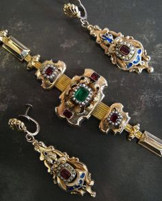 A beautiful Victorian gold bracelet & earrings suite with enamel emerald garnet paste & pearl decoration. Not on the site so DM for details!