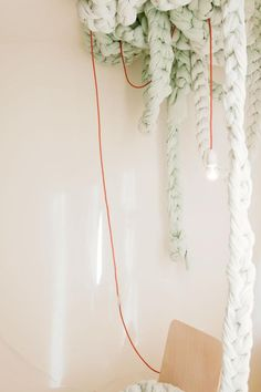 Simple/spare hanging light, artful vs. awkward cord solution.