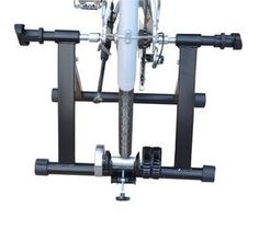 """Frugah Indoor Bicycle Bike Trainer Stand Kinetic Magnet Steel Stationary Sports by HOMCOM. $54.45. Heavy duty steel frame. Low resistance levels. Wind resistance. Easy fold for travel and storage. Features: -Can hook up to just about any bike-including road and mountain bikes with a 26"""", 27"""", or 700c wheel -The trainer Easy clamp locks down or bolts onto your bike's rear wheels Details: -Offers effective and convenient indoor training at a reasonable cost -The resistance traine..."""