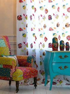 Babushka dolls as deco.  Love the chair too!