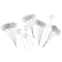 Use a spiral, silver wire card holder pick from Victoria Lynn™ as the perfect place card holder in individual floral arrangements or other small tabletop decorations. Great as place card holders for weddings, showers and more! 48 Six-inch silver wire card holder picks per package.