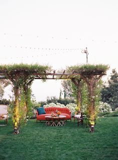 Backyard Arbor with Vibrant Lounge Furniture | Tec Petaja Photography | Bold and Colorful Fall Wedding in Burgundy, Orange, and Teal