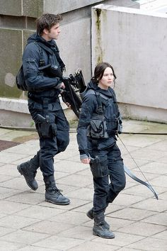 Jennifer Lawrence as Katniss in the set of The Hunger Games: Mockingjay. I can't wait!!!