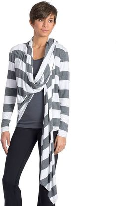 Ribbed contrast frames the printed body of a 4-way stretch yoga jacket cut from moisture wicking fabric with anti-microbial properties. Attached drawst -- Check out this great product.