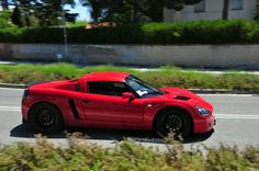 Red Opel Speedster with black rims http://bit.ly/1ewtFwi