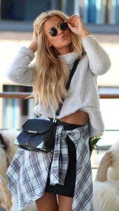 Lene Orvik is wearing a jumper from Zara, skirt from Never Denim, plaid shirt from BikBok and sunglasses from Rayban