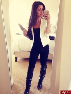 Fantastic outfit! Black on black with sexy tall boots and a crisp white blazer on top!
