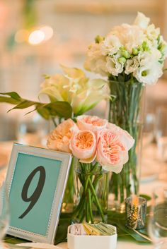 Lindsay & Nick   Wedding in Tampa Bay   Three-Tier centerpiece design made with peach Juliet Garden Roses, Lisianthus, and Calla Lillies. #andrealaynefloraldesign #tampaweddings