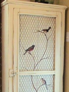 I love this decal behind the wire...this could be used on anything from kitchen cabinets to doors, to junk cabinets in the garage or potting shed.....sweet! This could also take on a mod twist with square screening and modern patterns behind...