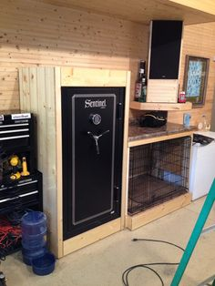 Garage, gun safe, kennel. I really like the framed-in safe, it cleans up the space a lot.