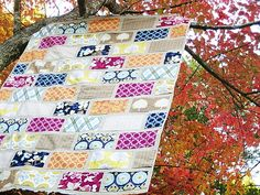 I've been looking for something to do with my Joel Dewberry fabrics ...  Modern Meadow Colorbrick Quilt by StitchedInColor, via Flickr