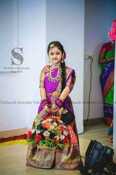 Cute little kid in Swathi Veldandi designed langa voni.