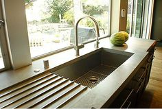 Love this idea of a built-in drainboard, no rack to take on/off the counter or look messy!