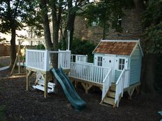 A cute playhouse on a low platform with lots of activities