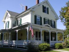Old Glory look beautiful flying on this Victorian home.