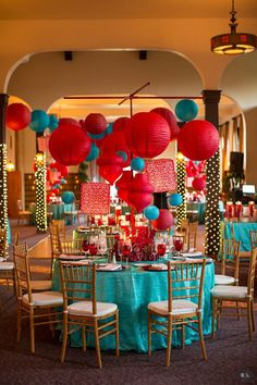 Red & Aqua wedding tables with lanterns and flowers