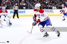 Mark Barberio #45 of the Montreal Canadiens gains control of the puck in the defensive zone with teammates Phillip Danault #24 and Carey Price #31 during the game against the Los Angeles Kings on December 4, 2016 at Staples Center in Los Angeles, California.