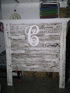 Full size headboard made from reclaimed pallets. LOVE!
