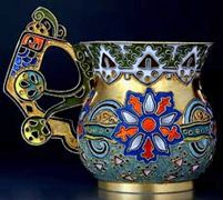 A SUPERB gilded silver and shaded cloisonne enamel antique Russian tea glass holder by the 11th Artel, made in Moscow between 1908 and 1917, decorated in the Modern style of the 1910s.