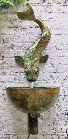 Fish sculpture wall fountain – Lucy Smith
