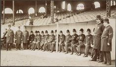 Boston Policemen pose in dugout at the Huntington Avenue Grounds, 1903 World Series