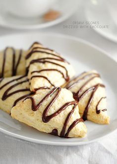 These cream scones drizzled with chocolate are a delicious dessert or treat for serving with coffee, hot chocolate or tea.
