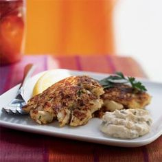 Louisiana Crab Cakes with Creole Tartar Sauce Recipe -- I am always trying new crab cake recipes.  And grating the onion is a real good tip so it's not so strong and cooks through.