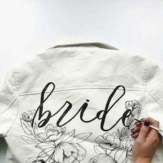White leather bride jacket with calligraphy. Image: Instagram/allikdesignHow bridal jackets got cool. #bridal #jacket